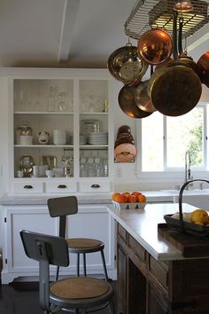 This is EXACTLY how I want my kitchen cupboards to look - all white, and well-organized enough to have no doors on them (but I'll paint or put a great wallpaper in the back and on the sides).