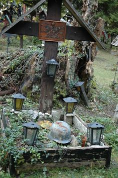 Grave from WW1 with helmet of the deceased, in an old cemetery in the woods close to Innsbruck/Tyrol, Austria