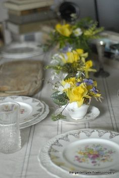 spring flowers for a vintage look.  Daffodils and Snowdrops in a Teacup - Vintage Wedding Theme still going strong 2013