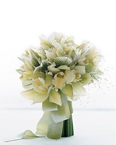 Modern White Bouquet  A splash of Panicum flowers injects youthful exuberance into an otherwise restrained bouquet of cymbidium and lady's slipper orchids with white nerines.