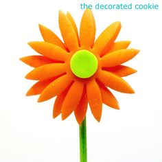 fondant gerbera daisies (on cookie pops) - The Decorated CookieThe Decorated Cookie