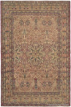 LAVER KIRMAN, 8ft 4in x 12ft 6in, 3rd Quarter, 19th Century.  This is a woven gem of a Persian carpet that features an exuberant, highly original composition centered about inventive starflower medallions, ingeniously composed of trees and blossoms. Simply mesmerizing, the lyrical pattern of curling vinery swirls on either side of the medallions, surrounding a seemingly infinite array of minuscule floral motifs.