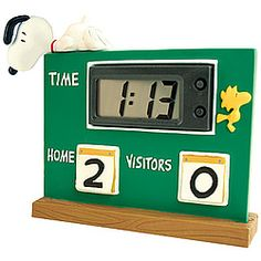 PEANUTS™ Snoopy Scoreboard Clock  Looks like our favorite beagle is taking the 7th inning stretch to heart!