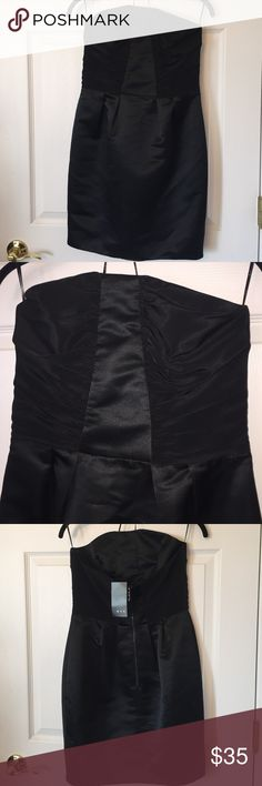 NWT Mango black satin strapless cocktail dress BNWT!! Classy, sexy, Size 8.  Mango black satin strapless mini dress with ruched bodice and zips up the back. Originally $119, I bought it on clearance for $71.94. To Whomever buys this dress: GO YOU! This dress is stunning, and what a bargain you got!😀 Mango Dresses Mini
