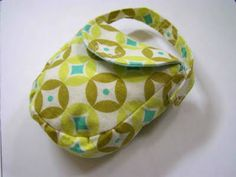 Pacifier pocket.  Keeps pacifiers clean when not in use.  Strap to car seat or diaper bag. Tutorial and Pattern by Ashley of Make it and Love It