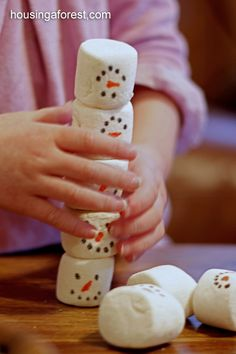Minute to Win It: How high can you stack your snowmen in one minute without falling?