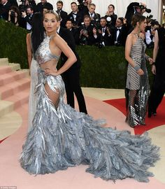 Shine ya light: Rita Ora followed up the British army in a feathered gown that was silver from top to tip
