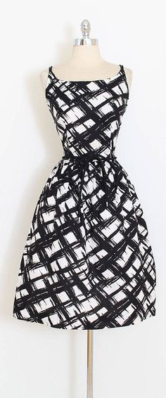 ➳ vintage 1950s dress * darling black white cotton pique * abstract plaid print * metal back zipper * rope tie belt * by Sears condition | excellent fits like large length 41.5 bodice 17 bust 38 (2 finished seam allowance) waist 30-31 hem allowance 2 ➳ shop http://www.etsy.com/shop/millstreetvintage?ref=si_shop ➳ shop policies http://www.etsy.com/shop/millstreetvintage/policy twitter | MillStVintage facebook | millstreetvintage instagra...