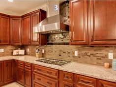 Kitchen Renovations from Granite Transformations of Northeast Ohio. Superior granite countertops and mosaic backsplashes.