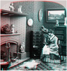 »The stereograph as an educator« – Underwood & Underwood, New York, 1901 »Photograph shows a woman viewing stereographs in her home; she is sitting in front of a fireplace with a cabinet for stereographs on her right.« (Quelle: Online-Catalog der Library of Congress)