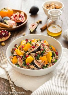 Roasted Delicata Squash, Fig, and Persimmon Wild Rice Salad with kale, pomegranate, and tossed in a spiced maple vinaigrette