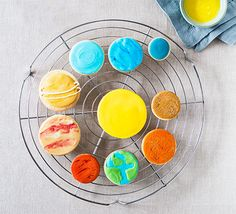 Make a whole solar system from your kitchen with our super cute planet cookies! The baking and decorating will keep even the most energetic children busy over the half-term break Orange Food Coloring, Gel Food Coloring, Edible Gold Glitter, Royal Icing Sugar, Blue Icing, Blue Food, Space Party, Bbc Good Food Recipes, Orange Recipes