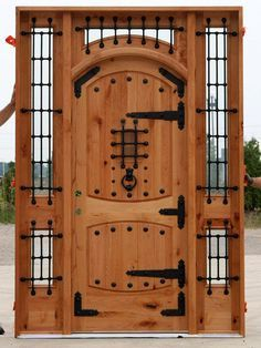 Rustic Arched Doors with Sidelights and Transom with a clear coat finish. Rustic Maple Wood Door has Custom Wrought Iron Work Grills over it's Clear Insulated Glass and Speakeasy. Arched Doors, Entrance Doors, Internal Doors, Patio Doors, Wooden Gates, Wooden Doors, Castle Doors, Double Front Doors, Cool Doors