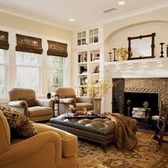 Family Room ♥ Love the dark shades paired with the light color walls.  The furniture is nice.. I must have the large Ottoman / coffee table!