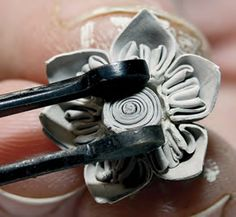 """Learn how to do quilling with metal clay with the FREE project, """"Wire Wrapped Metal Clay Bouquet,"""" by Paula Bastian-De Leon. Quilling is an ancient art form that creates design using narrow strips of paper that have been rolled, shaped, and arranged. It's very much like filigree, only with paper in place of metal.   #metalclay #jewelry"""