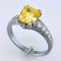 A very fine, unheated Sri Lankan yellow sapphire in white gold with diamonds.