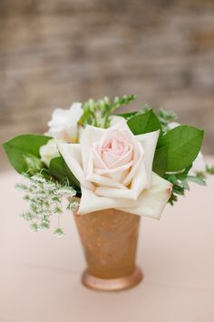 I like these vases...  lauraivanova.com Event Planning: Premier Planning Services, Inc   premierplanningservices.com Floral Design: Summer Harsh Botanical Artistry   summerharshbotanicalartistry.com/   View more: http://stylemepretty.com/vault/gallery/13019