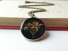 Gorgeously vintage-inspired! Real dried flower pendant in burnished orange £16.00. #accessories #folksy #uk