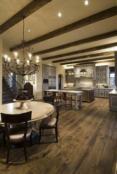 Recessed box ceiling with beams in kitchen. Beams to run perpendicular to the trusses in the living room.