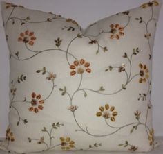 "This Robert Allen Galway Bay embroidered linen fabric was one of our fabulous ""rescues"". We found just enough to make two matching pillows. The same fabric is on the front and back. This fabric retails for $99/yard. The colorway is parchment."