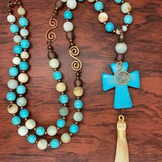 I made these long pendant necklace using cream and blue amazonite beads and blue magnesite beads with hand formed copper accents. The pendant is a cross with a spiral copper dangle and a tassel. The necklace is approximately 34 1/2 inches long. The dangle adds an additional 7 inches.  www.zerenitytreasures.com. ***Needed skinny model without the extra quarantine pounds!!!🤣🤣🤣**** Treasures Jewelry, Copper Accents, Long Pendant Necklace, Spiral, Turquoise Necklace, Tassel, Dangles, Skinny, Cream
