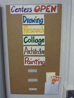 Easy method for posting daily centers. Use velcro to attach signs