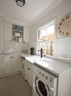 all white laundry room