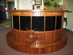 Nautical theme by the pool would also be nice! Custom made Boat Bar - tropical - bar tables - cleveland - by Custom Storage Solutions