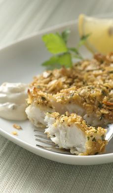 Lemon Pepper Cornflake-Crusted Tilapia  2 Tablespoons olive oil or cooking spray 1/3 cup all-purpose flour 1/2 teaspoon each salt and pepper (or to taste) 2 large eggs, lightly beaten 2 cups unsweetened cornflakes 1 Tablespoon lemon pepper 1 Tablespoon dried parsley, or 2 teaspoons fresh parsley, finely chopped 4 tilapia fillets, 4 ounces each, rinsed and patted dry 1 lemon, quartered