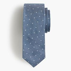 """Sometimes you want to wear a tie even when you don't have to. This one is made from a blend of English silk and linen and has a classic polka-dot pattern that instantly elevates just about anything you wear it with. Fun fact: It's handmade in New York City's Long Island City. <ul><li>2 3/4"""" at widest point.</li><li>English silk/linen.</li><li>Made in the USA.</li></ul>"""