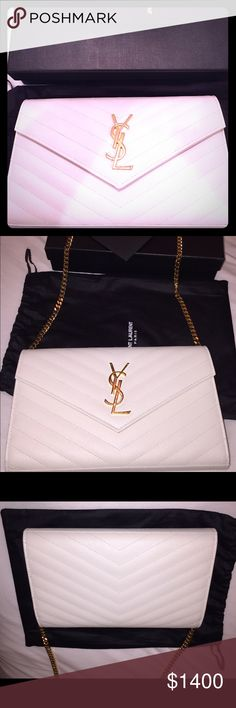 Saint Laurent white wallet on chain (medium) Saint Laurent wallet on chain white with gold hardware and chevron stitching. This is the bigger size of the wallet on chains. Comes with one zipper, holds 24 cards, and two compartments for cash or misc. This bag has a removable chain to turn into a clutch, wallet or a shoulder bag. Comes with all forms of authenticity, dust bag and box. This has been used ONLY 4 times in pristine condition just one tiny ant size scratch on Ysl logo. NO TRADES OR…
