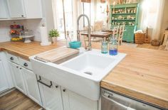 Small+country+kitchen+with+white+cabinets,+butcher+block+counters+and+double+sided+farmhouse+sink