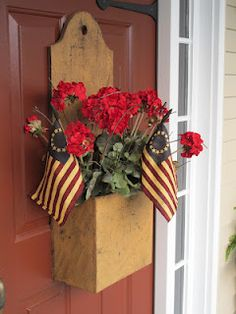Prim Mustard Door Box...filled with red geraniums & flags...Yesterday Once More.