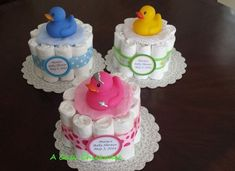 Mini Diaper cakes with Rubber Duckies perfect for center pieces at any baby shower or gender reveal party # diy # diycrafts Baby Cakes, Baby Shower Cakes, Small Diaper Cakes, Baby Shower Diapers, Baby Shower Fun, Baby Shower Parties, Baby Shower Gifts, Baby Showers, Diy Diaper Cake