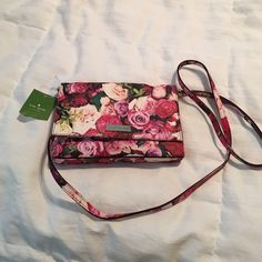 NWT, Kate Spade Floral Crossbody, Sally Style Brand new with tags, never carried. Sally Style, Grant Street Floral, authentic . Will hold i phone 6 , roomy. 8 in length, a little over 4 deep kate spade Bags Crossbody Bags