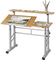 Create works of art in relative comfort with this Split Level Drafting Table which can adjust in height.