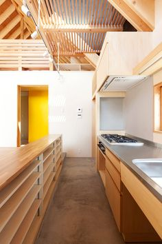 Tailored Design Lab have built a house in rural Japan that embraces its agrarian setting.