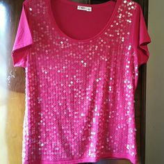 Cato Sequined Tee XL A bright pink Cato tee with large, clear sequins on the front size XL. I don't see any missing sequins but it would be hard to tell. 66% polyester 34% rayon. There is some light pilling throughout the shirt as seen in the last photo Cato Tops Tees - Short Sleeve