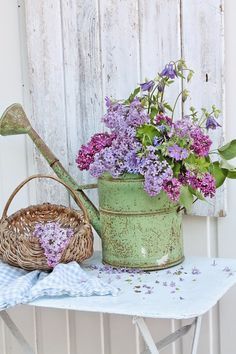 LOVE this old watering can and french enamel table! Pretty any where you need a little touch of beautiful :-)