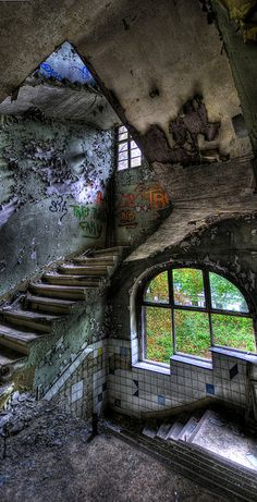 A vertical panorama of a stair case in the abandoned children's hospital in north Berlin.- photo by Keith Thorne