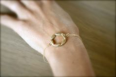 delicate gold circle// @Erin Rosel, I feel like you would wear this.