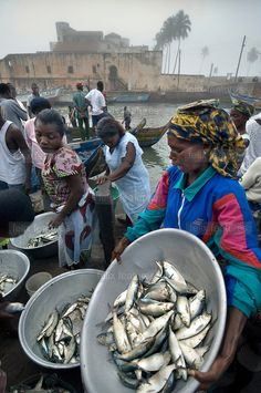 selling fish in front of Elmina castle, Ghana (built by the Portuguese in 1482 as a slave trading post)