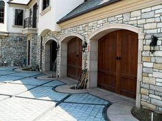 Garage Doors with Stone Trim. Don't like the casing alternating width but the jambs are awesome.