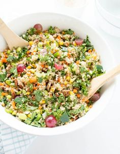 California Chopped Kale Salad. Vegan, Gluten Free. Quinoa, kale and all the veggies, plus flaked coconut & juicy grapes with a champagne vinaigrette. From The Glowing Fridge #vegan #summer #chopped #salad