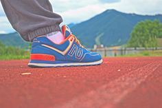 NewBalance, blue/orange shoe  vs Lap - Capturing New Balance shoes on running lap, in background is mountain called Poludnica.