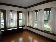 Nice! A lot of windows in this living room. Outstanding Historic Prairie Style home with character from top to bottom. Five bedrooms, 2 baths, beautiful hardwood floors, red tile roof, original 2 stall garage with tile roof (new doors), updated wiring, newer central air, built-ins in the living and dining, French doors, lead glass, beautiful crown molding, plus much more. This home has most all of its original features and they are in great condition.