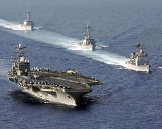 South China Sea (April 16, 2006) - USS Mobile Bay (CG 53), USS Russell (DDG 59), and USS Shoup (DDG 86) perform a pass-in-review with the Nimitz-class aircraft carrier USS Abraham Lincoln (CVN 72). Lincoln and embarked Carrier Air Wing Two (CVW-2) are currently underway to the Western Pacific for a scheduled deployment. U.S. Navy photo by Photographers Mate Airman Timothy C. Roache Jr. (RELEASED)