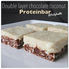 For 4 squares: Bottom layer: 1/3C quinoa puffs, 2T oats, 2t cocoa, 1 scoop chocolate whey, 1/2T granulated stevia, 2T almond butter, 2T almond milk. Top layer: 1 scoop vanilla casein, 3T shredded coconut, 5T low fat coconut milk. Mix ingredients for the bottom w/spoon & press down in a small baking dish (w/parchment paper). Freeze. Mix ingredients for top layer & spread over bottom. Put in the fridge until set.