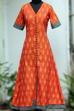 Buy Maati Crafts Orange Cotton printed Shirt Style AnarkalI Kurti online in India at best price.a long kurta with orange ikat & sage green steel buttons! the main fabric is handloom, handwoven ikat Printed Kurti Designs, Churidar Designs, Kurta Designs Women, Blouse Designs, Dress Designs, Kurta Patterns, Dress Patterns, Indian Dresses, Indian Outfits