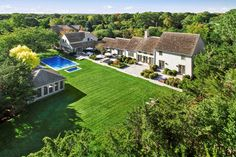 Set amid approx. 2.7 acres of enchanting gardens and located just moments from Sag Harbor Village, this inspired 6-bedroom, 7-bath masterpiece with interiors by renowned designer David Scott is the pinnacle of style and function. Gated gravel drive leads through a magical landscape of specimen trees and meadows to the long shingled house with staggered roof lines.   The main entry foyer opens to 2 luxurious entertaining spaces: the expansive, double height living room featuring a Belgian…